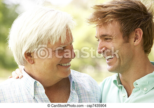Portrait Of Senior Man Talking To Adult Son - csp7435904