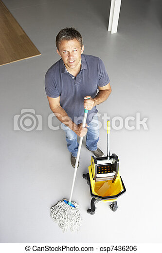 Cleaner mopping office floor - csp7436206