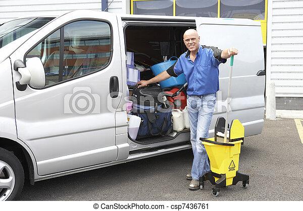 Cleaner standing next to van - csp7436761