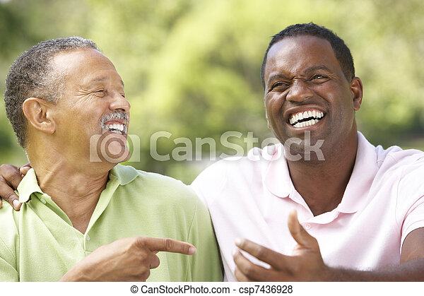 Father With Adult Son In Park - csp7436928