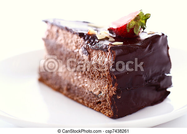 Slice of tasty chocolate cake with strawberry on top - csp7438261