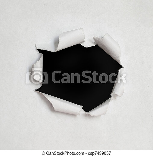 Hole in the paper with torn sides. - csp7439057