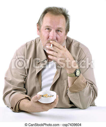 horrified man in his 50s sitting at a table with a cigarette and ashtray - csp7439604