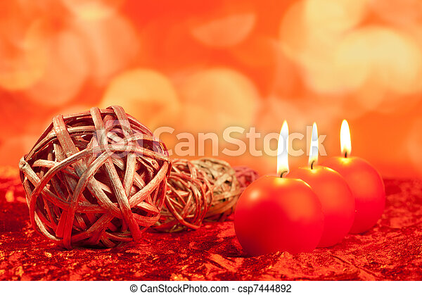 christmas candles with dried baubles on red - csp7444892