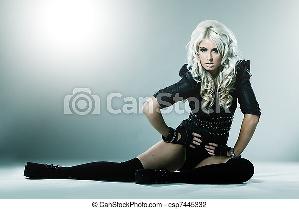 Young blonde in attractive high fashion black clothes - csp7445332