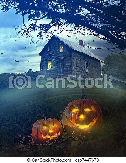 Halloween pumpkins in front of Spooky house - csp7447679