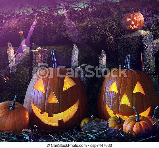 Halloween pumpkins in the grave yard - csp7447680