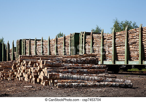 Commodity cars transporting wood stand in a warehouse - csp7453704