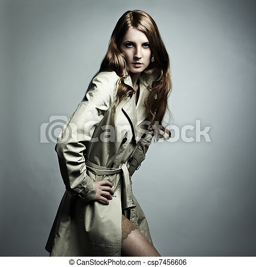 Fashion portrait of young beautiful woman in the raincoat - csp7456606