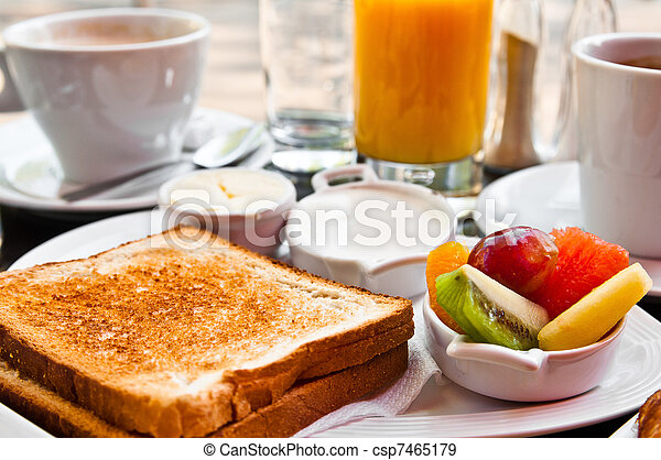 Breakfast with orange juice and fresh fruits on table - csp7465179