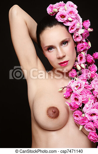 Young attractive naked pregnant woman with pink flowers in her hair