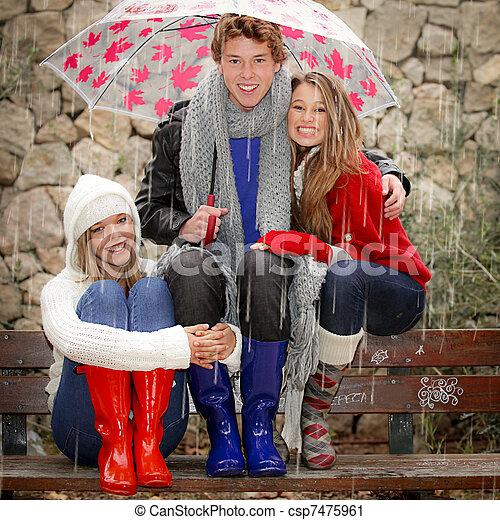 happy smiles in the rain with umbrella - csp7475961