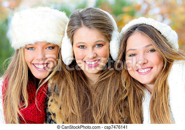 group of winter girls or young women with perfect white teeth - csp7476141