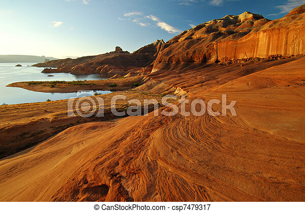 Magnificent red sandstone formations along the shores of Lake Powell, Arizona, United States. - csp7479317