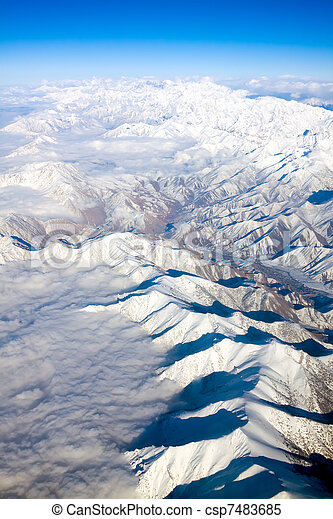 Aerial view of snow-covered mountains - csp7483685