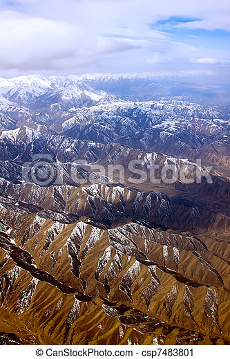 Dramatic aerial view of rocky mountains - csp7483801