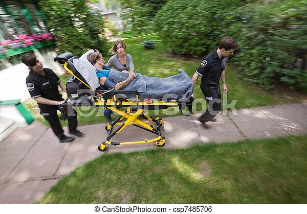 Senior Woman with Emergency Medical  Help - csp7485706