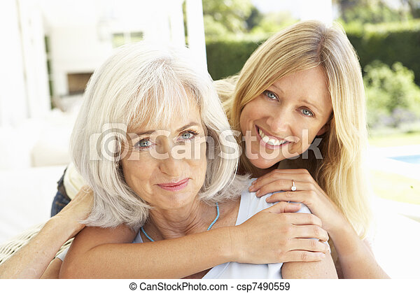 Portrait Of Mother And Adult Daughter Relaxing On Sofa - csp7490559