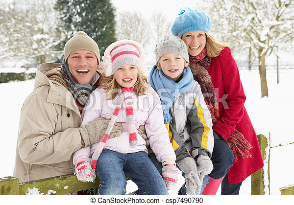 Family Sitting In Snowy Landscape - csp7490790