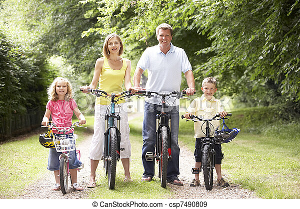 Family riding bikes in countryside - csp7490809