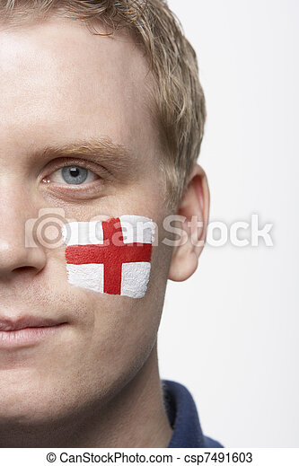 Young Male Sports Fan With St Georges Flag Painted On Face - csp7491603