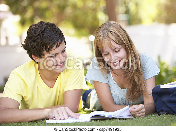 Teenage Student Couple Studying In Park - csp7491935