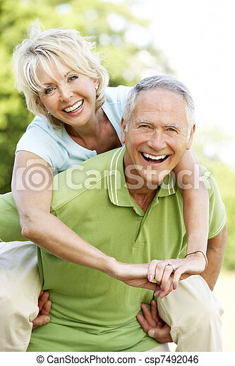 Mature couple having fun in countryside - csp7492046
