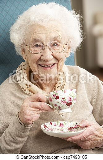 Senior Woman Enjoying Cup Of Tea At Home - csp7493105