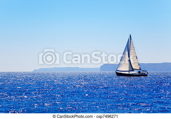 Blue Mediterranean sailboat sailing - csp7496271