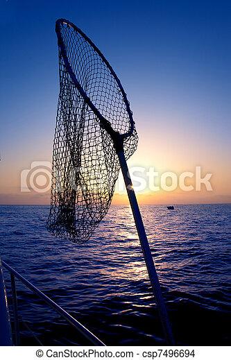 dip net in boat fishing on sunrise saltwater - csp7496694