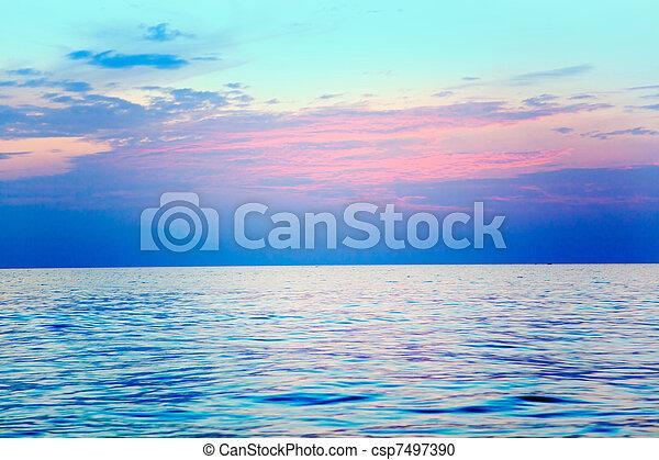 Mediterranean sea sunrise water horizon - csp7497390