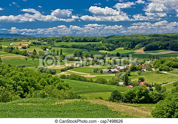 Beautiful green scenery landscape in spring time - csp7498626