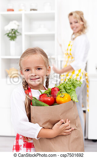 Little girl with the groceries bag - csp7501692
