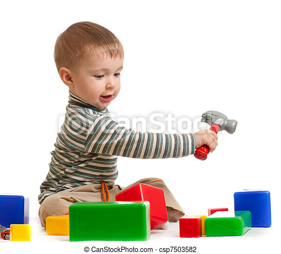 little boy with tools and building blocks - csp7503582