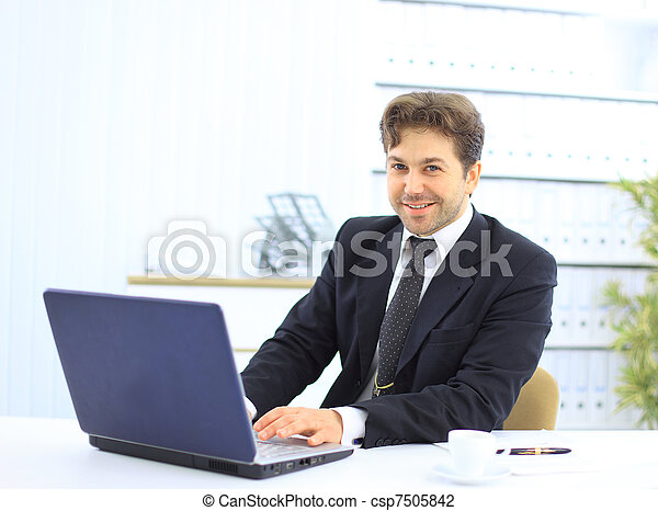Closeup of employee in the office working on laptop computer - csp7505842