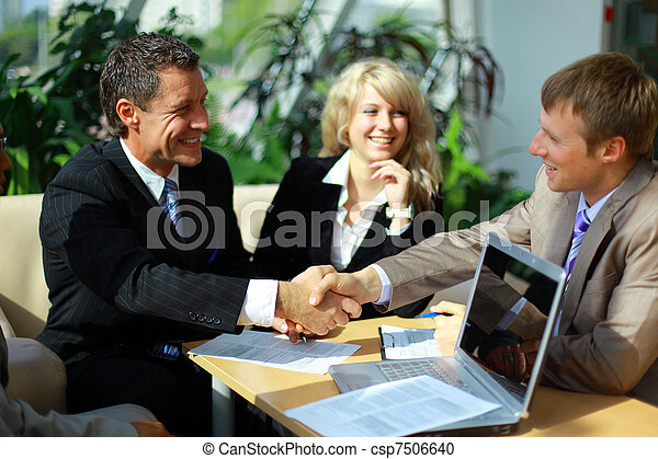 Business people shaking hands, finishing up a meeting - csp7506640