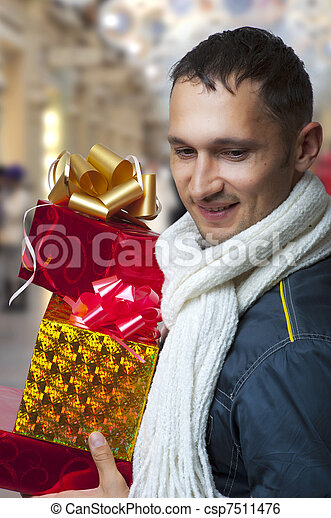 Young adult man with christmas gifts - csp7511476