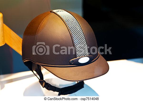 Helmet of the jockey in a shop show-window   - csp7514048