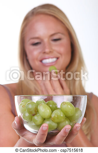 Healthy Young Woman Eating Nutritious Food - csp7515618