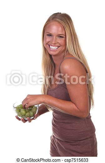 Healthy Young Woman Eating Nutritious Food - csp7515633