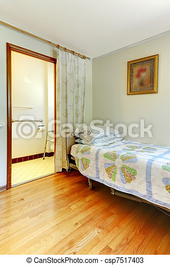 Assistant living bedroom with handicap bathroom - csp7517403