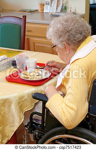 Old woman eating lunch in handicap chair - csp7517423