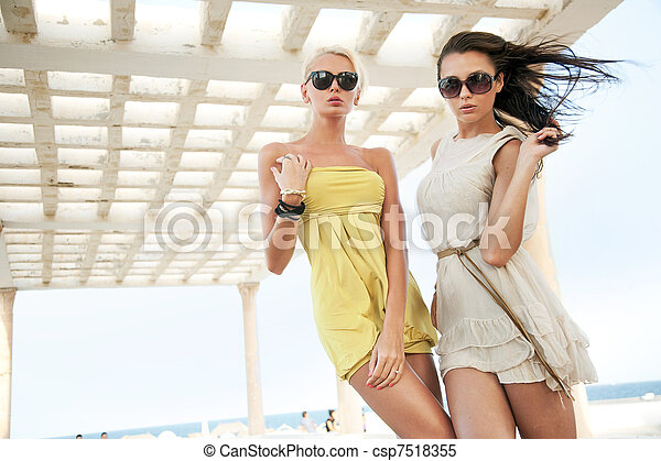 adorable women wearing sunglasses - csp7518355