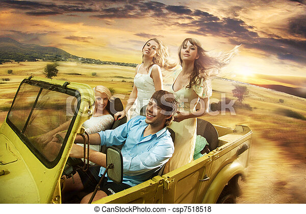 Group of cheerful friends driving a cabriolet - csp7518518
