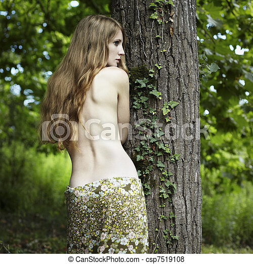 Portrait of romantic woman at the green forest - csp7519108