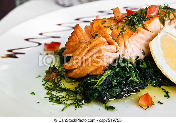 grilled salmon and lemon - french cuisine dish with tomato and salmon - csp7519755