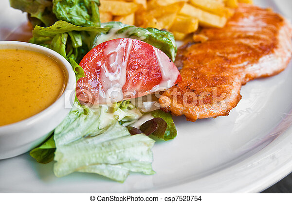 grilled salmon and lemon - french cuisine dish with tomato and salmon - csp7520754