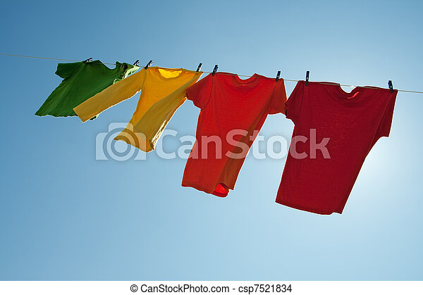 Colorful clothes hanging to dry in the blue sky - csp7521834