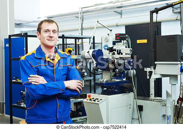 worker at tool workshop - csp7522414