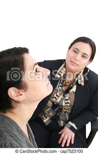 psychologist or psychiatrist listening to patient - csp7523100